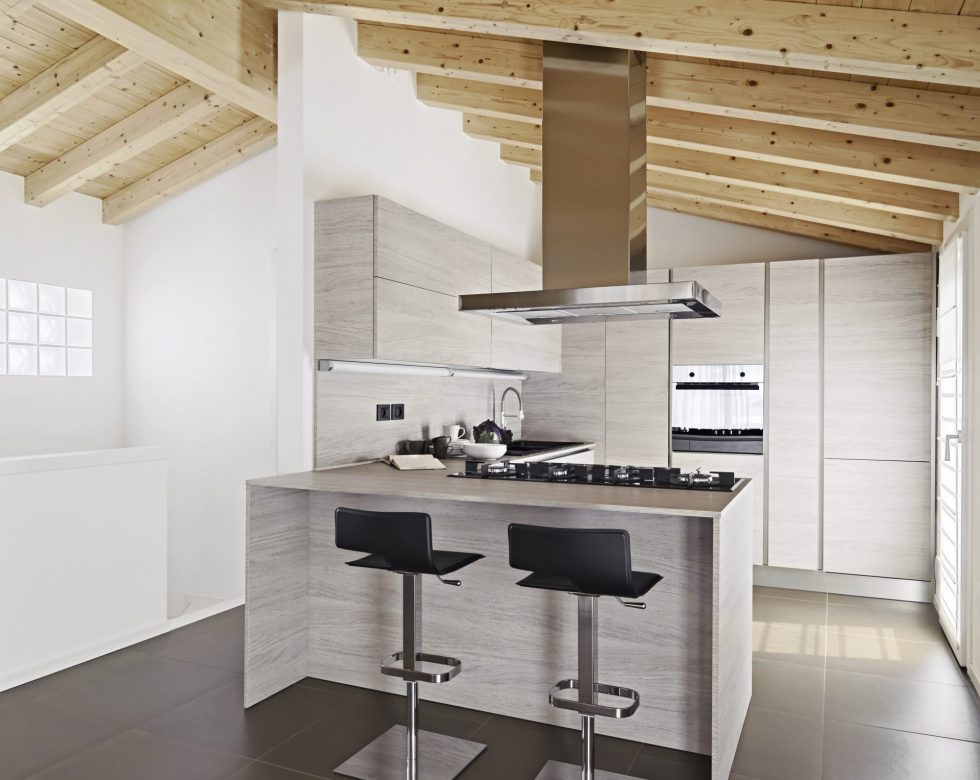 dinng  table and modern kitchen in the villa with wood ceiling and tile flor